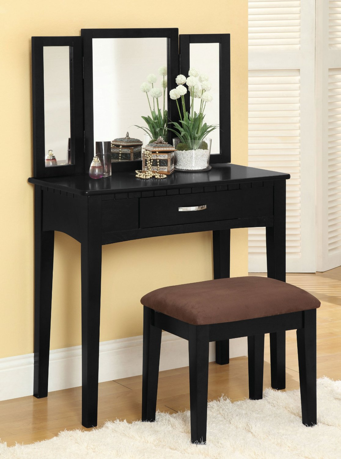 Semi matte black painted dressing table consisting of drawer and a mirror frame. Along with it was also manufactured a stool with upholstery. Best dressing tables in sharjah.