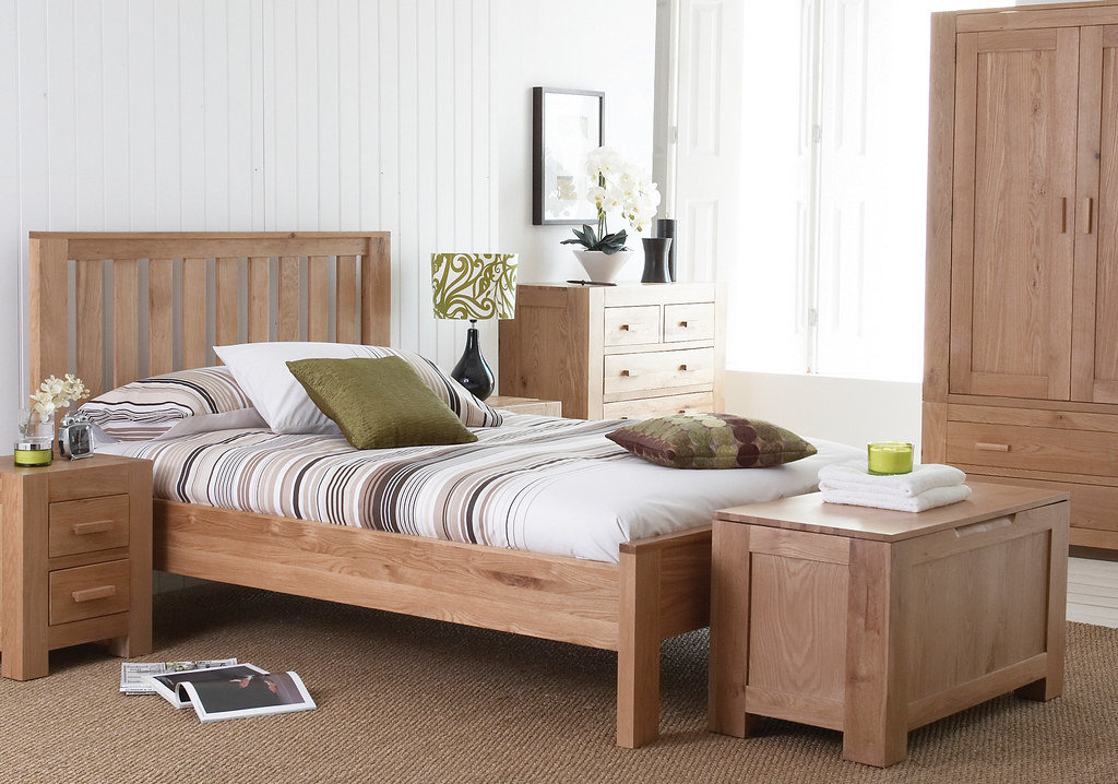 Simply designed and manufactured bed, bedside tables, a chest of drawers, a simple wardrobes consisting of doors and drawer units and a storage bench all manufactured using beech veneer. Best bedroom designs in uae.
