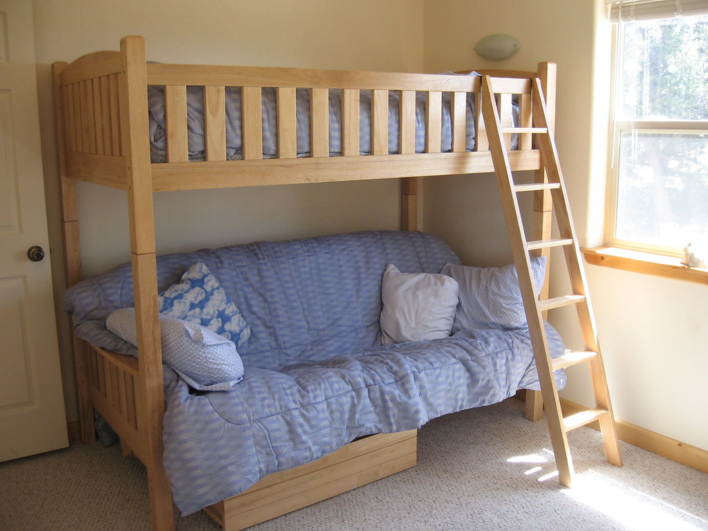 Exquisite bunk bed manufactured using solid ash wood along with angled ladder polished natural. Best cabinets in Ajman