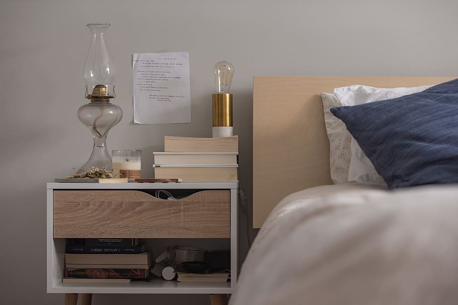 Lavish nightstand manufactured using melamine with the head for the drawer manufactured using ash veneer.
