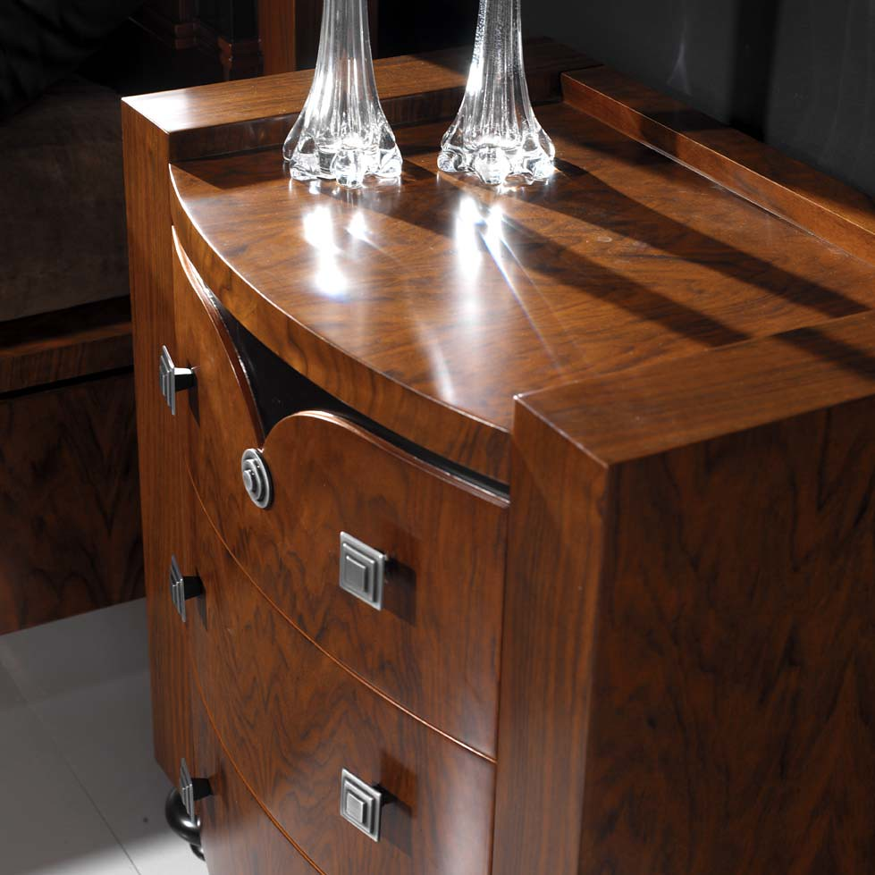 An artistically designed bedside table consisting of drawers.