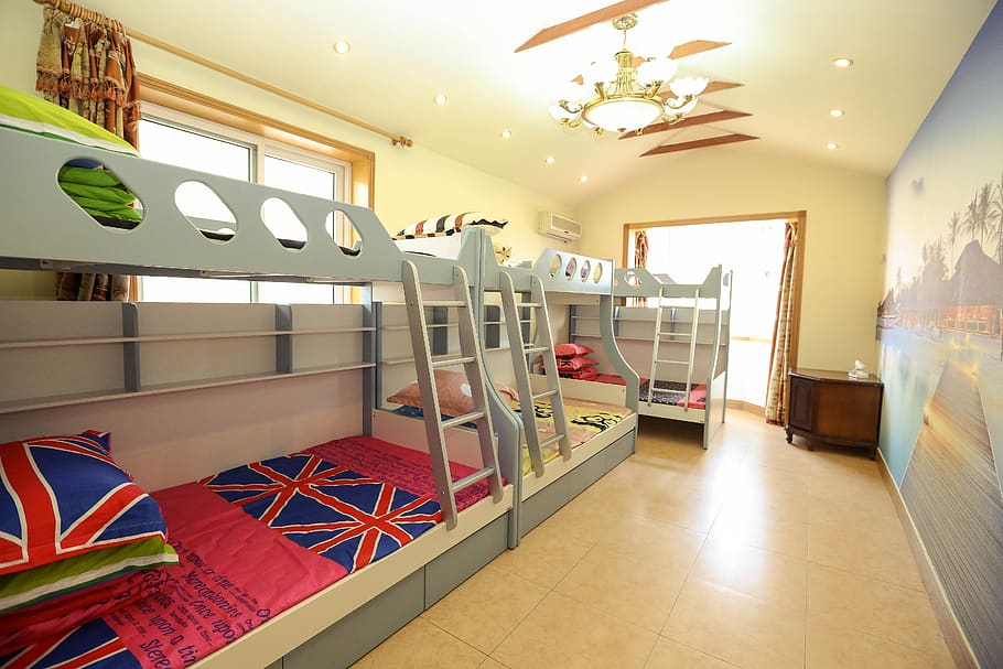 Manufacturing of a ship shaped bunk bed painted matte grey along with ladders in between and storage area underneath. Best wardrobes in sharjah.