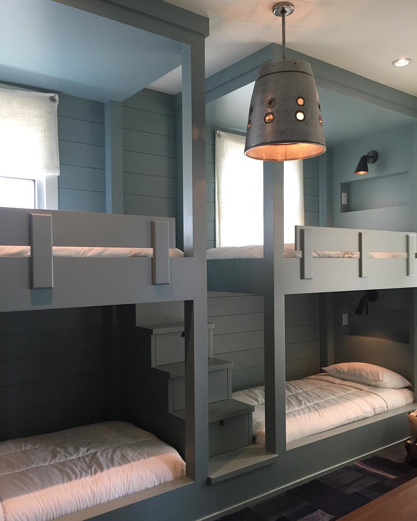 Manufacturing of a simple yet elegant full height bunk bed with stairs in between painted grey. Affordable dressers in dubai.