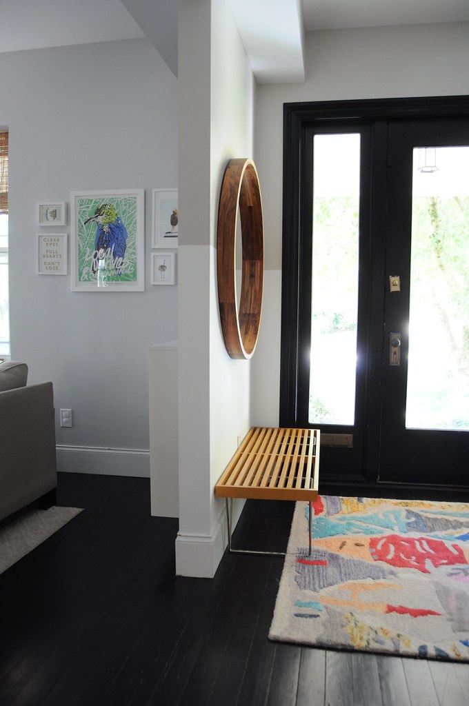 A solid wooden seating bench along with metal legs for support. Also manufactured was a contemporary round mirror frame