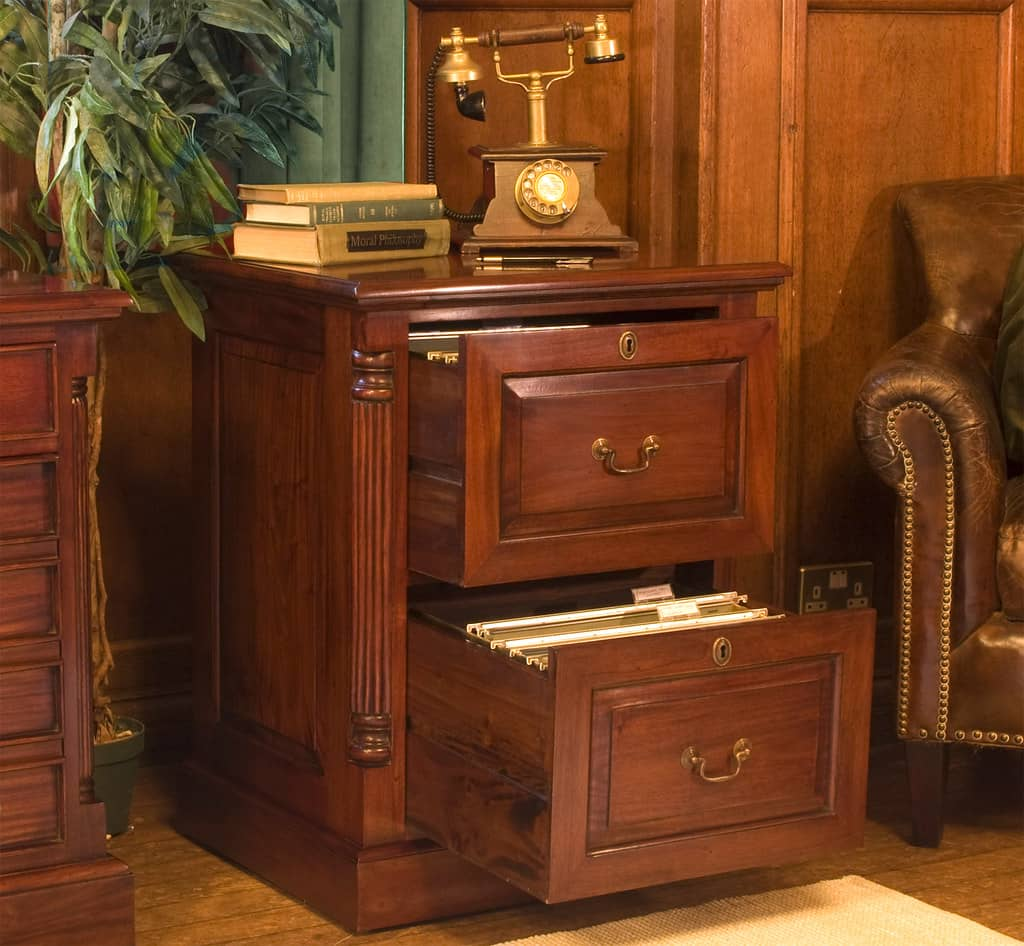 Telephone stand manufactured using chestnut veneer with design drawers and sides along with antique handles and artistically designed edges. Beautiful console table sharjah.