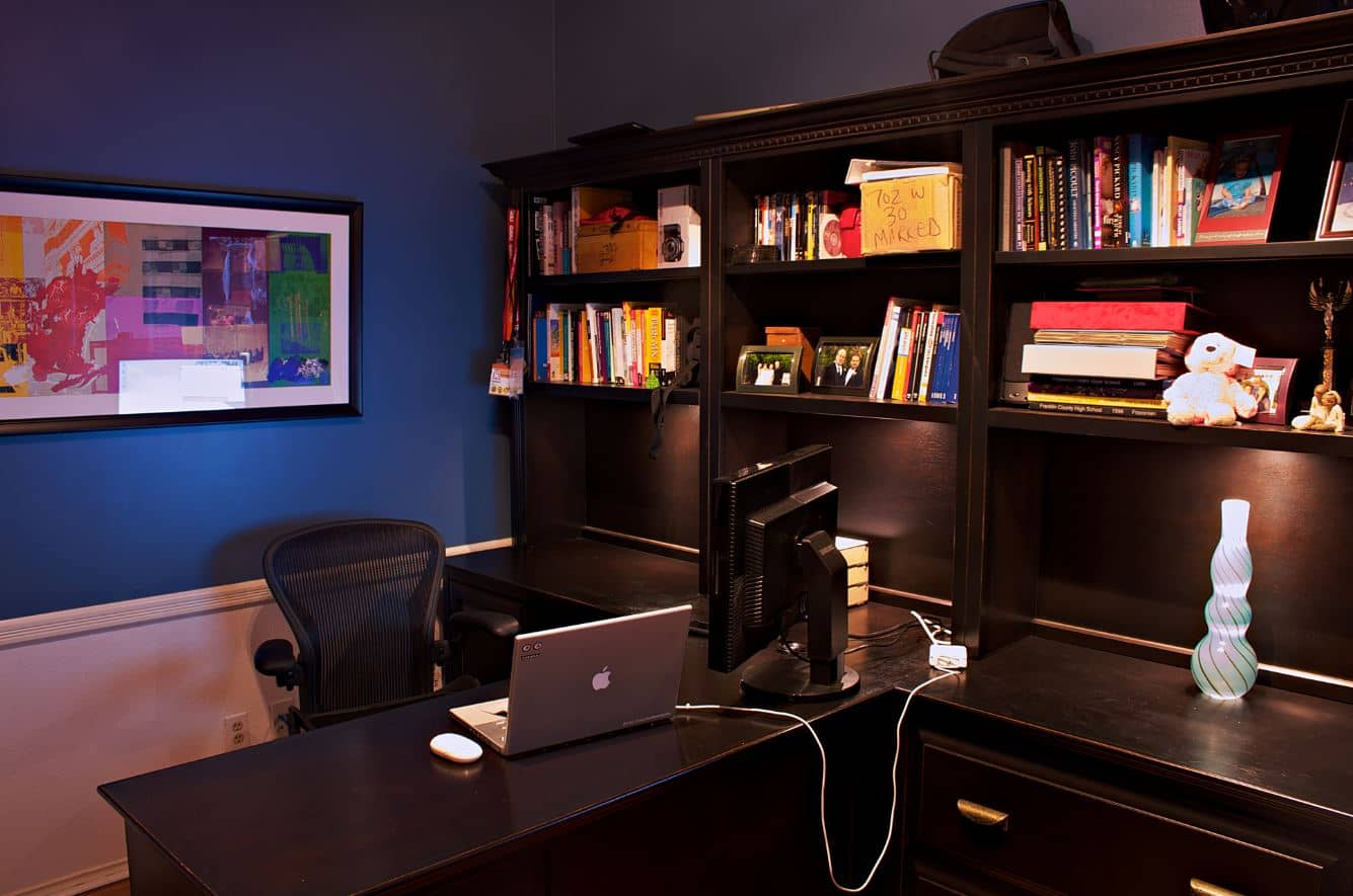 Dark mahogany polished open shelving cabinetry along with computer desk.
