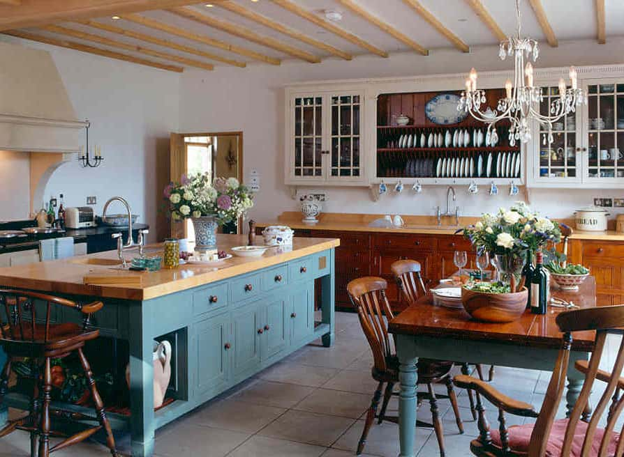 Turquoise painted centre island consisting of doors and drawer units consisting of solid wooden top.