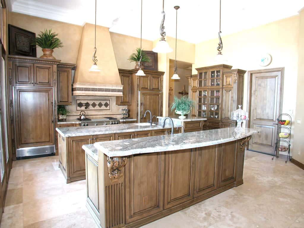 Chocolate brown polished kitchen cabinet consisting of high end design with marble top.