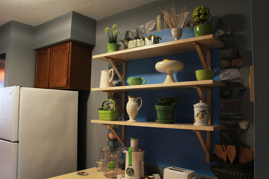 Hard maple melamine floating shelving units.