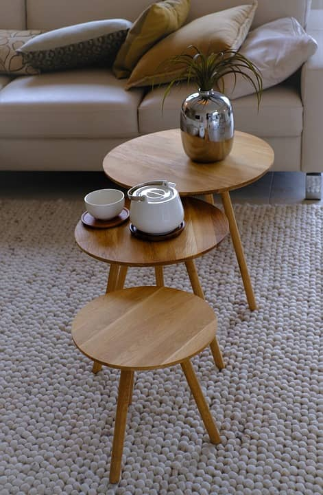 Three different size of coffee tables with round spindles manufactured using beech wood painted tint dark.