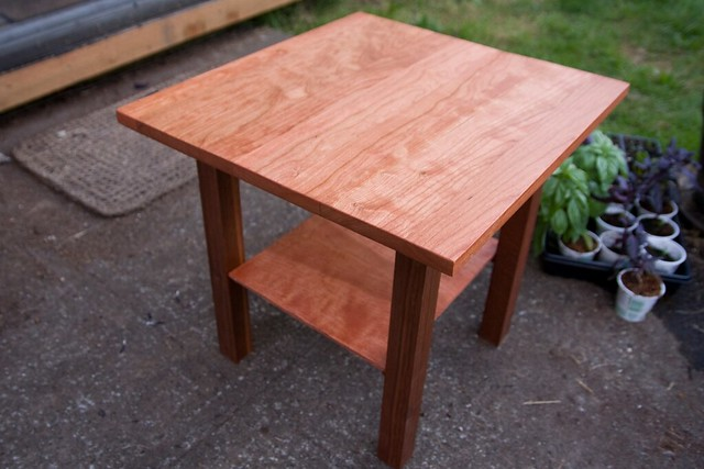 A small tower table polished red mahogany.