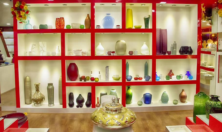 A decorative cabinet made to display design vase painted red and white. Best shop furniture dubai.