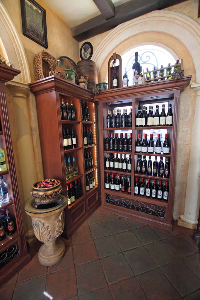 L - Type wine storage consisting of open shelves and design molding on top for a villa in Fujairah.