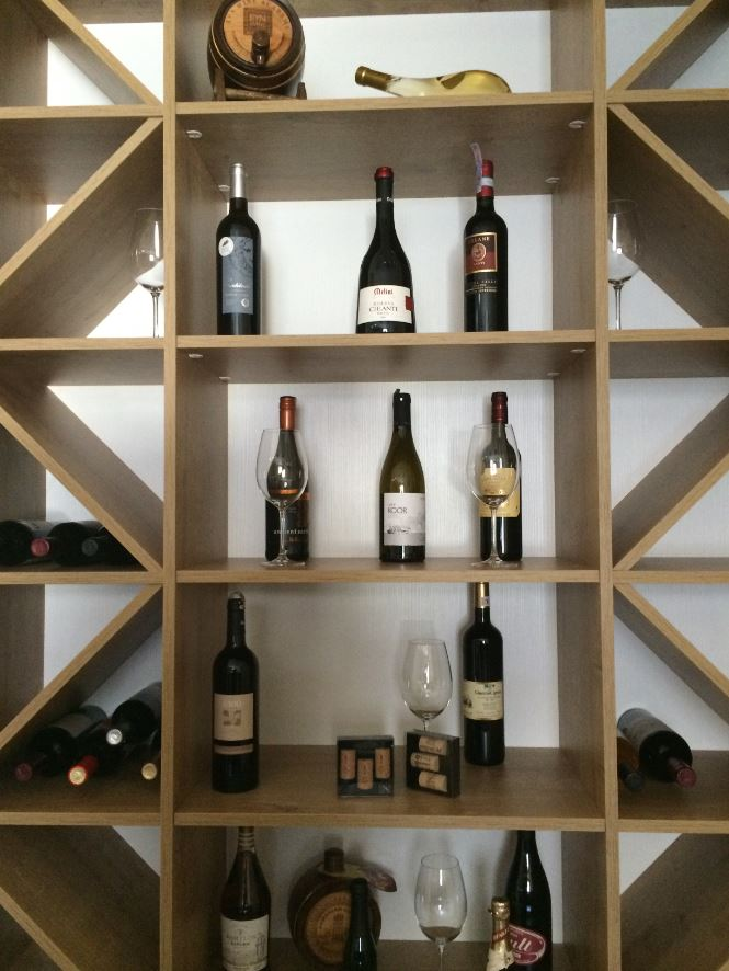 Close view of storage cabinet consisting of shelves for wines.