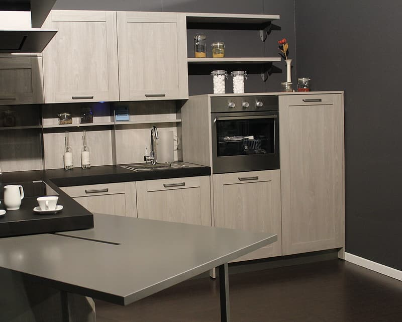 White ash manufactured storage cabinet along with area for sink and faucet and floating shelves.