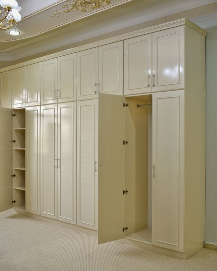 Showcasing the inside of the cupboard consisting of shelves, hangers and drawer units.