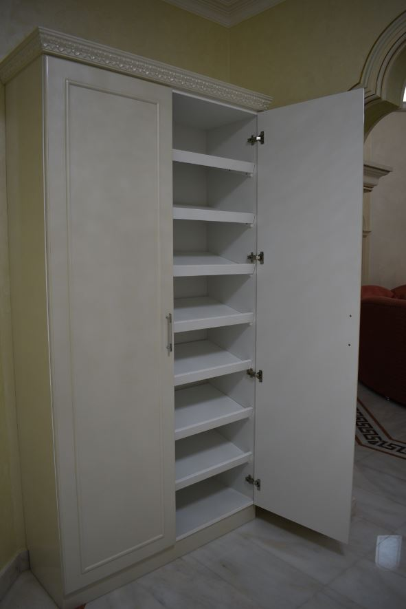The shoe rack was painted mother pearl on the exterior and the interior was made using white melamine MDF.