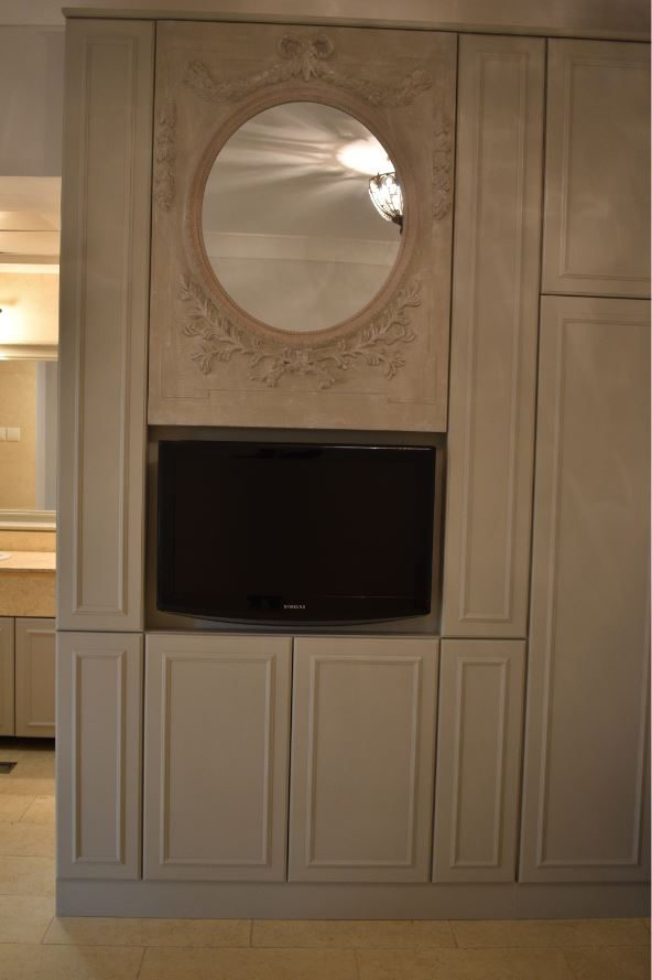 Picture of the mirror frame showcasing the beauty that its adding to the cabinet with artistic gypsum designed frame painted matte grey.
