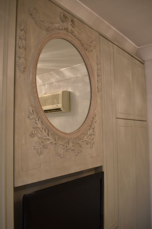 Zoomed view of the gypsum mirror frame designed antiquely for a residence in mirdif, dubai.