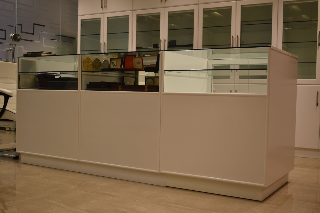 Centre display unit made for an office in al mamzar, dubai consisting of display panel on top consisting of glass panels.
