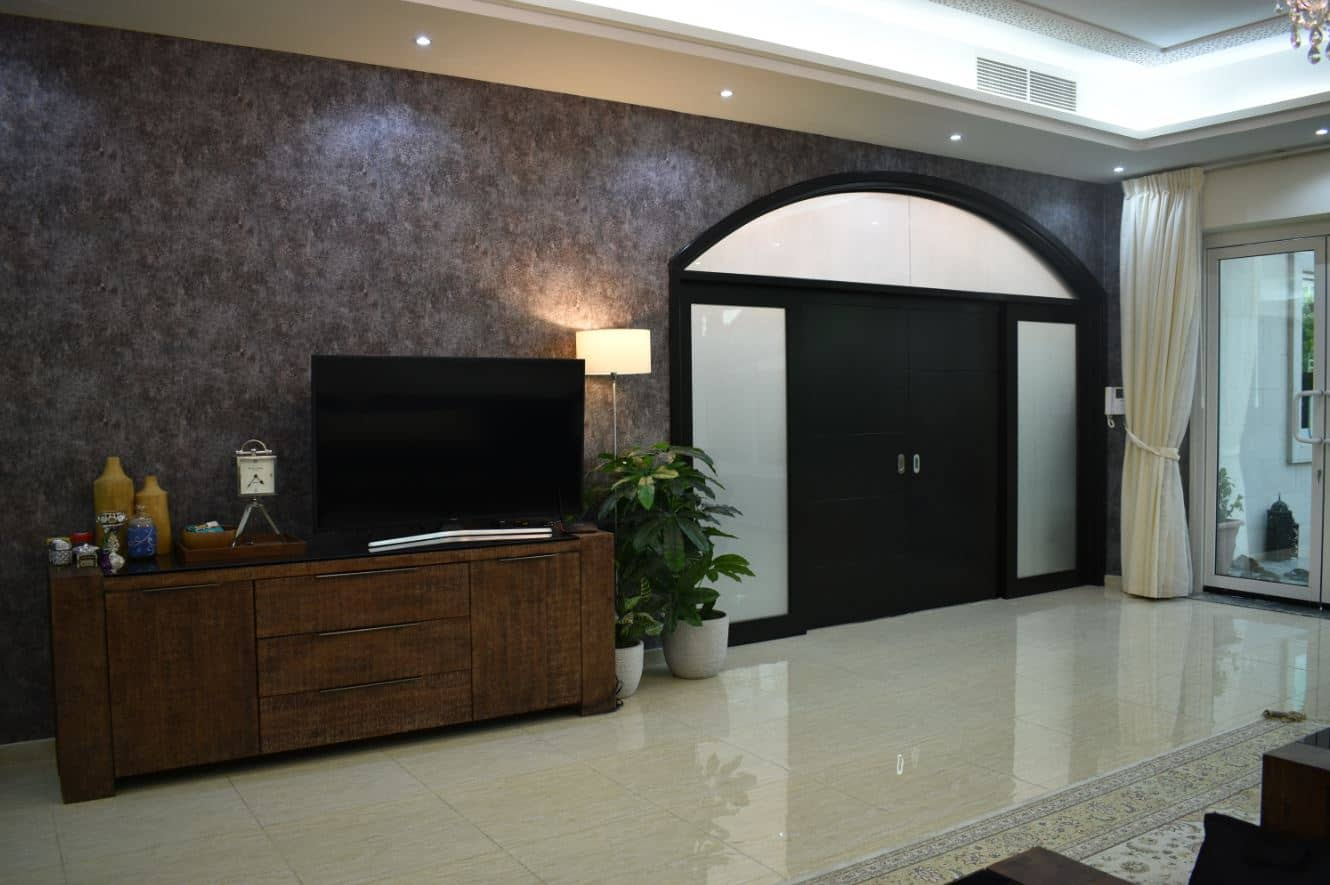 Sliding solid wooden door polished dark mahogany with architraves and frame made for a villa in mirdif, dubai.