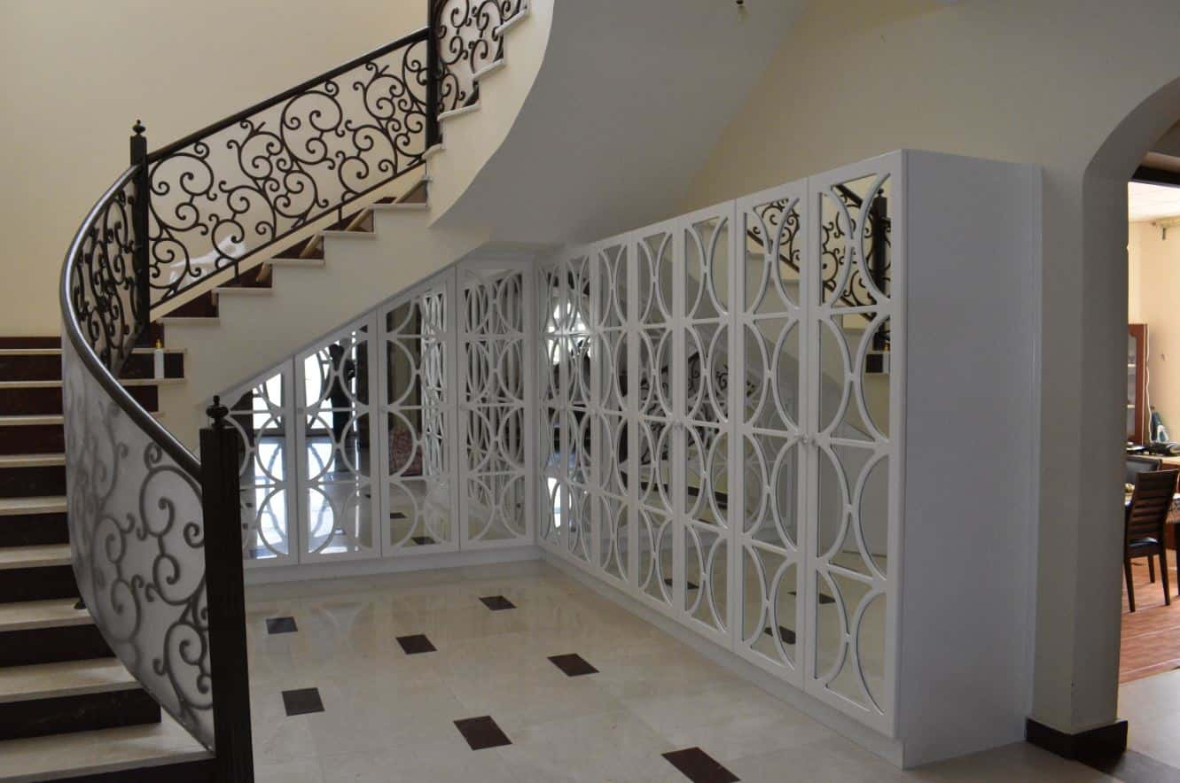 Manufacturing of whole white understair storage covering the whole area without wasting any space.