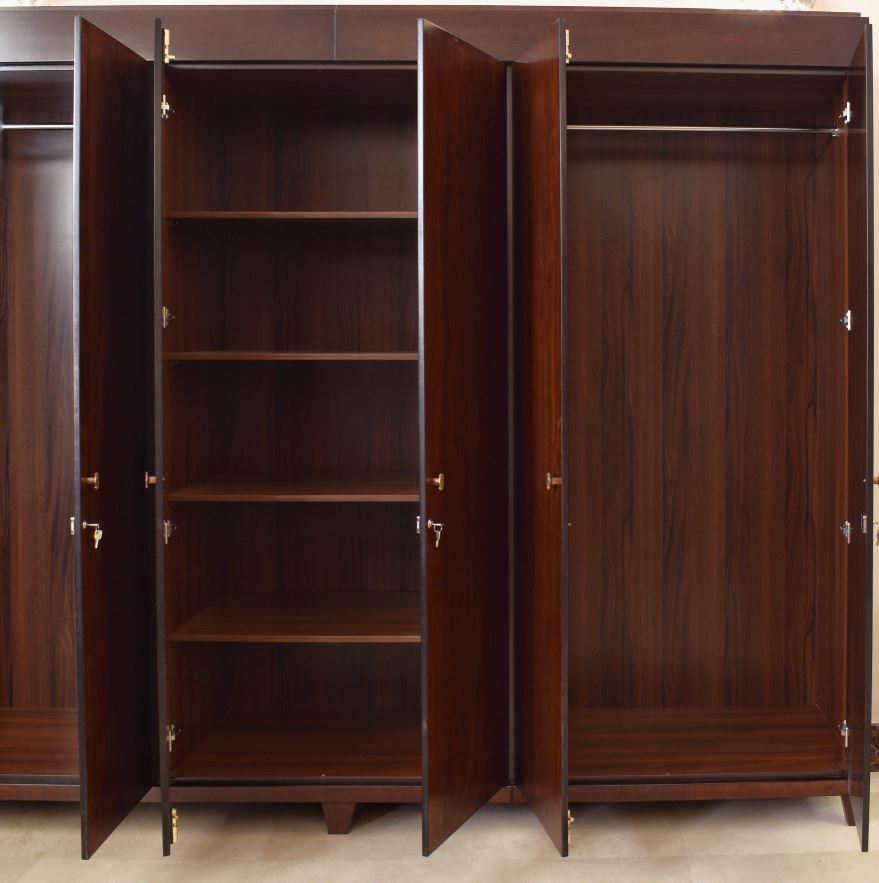 The cupboard consisted of doors polished dark mahogany using jet stain with golden knobs, soft closing hinges and locks.